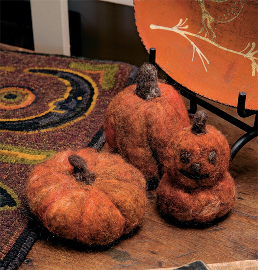 Make pumpkins with needle felting