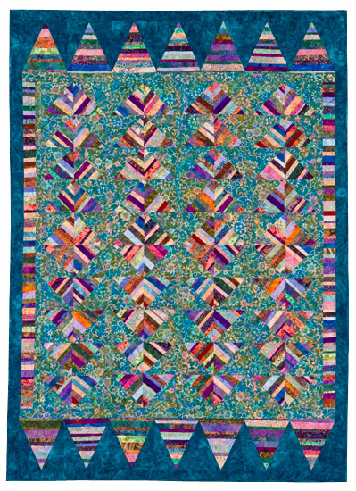 Blue scrappy quilt from SuperStrata Quilts